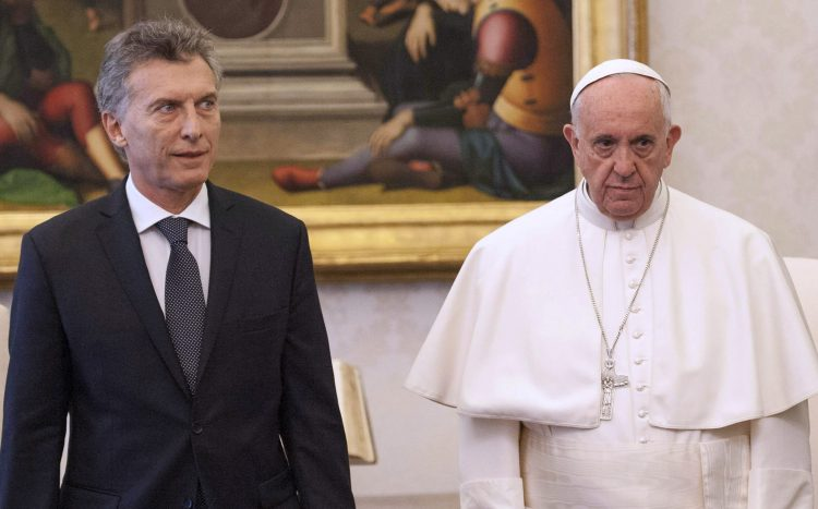 Argentina's president Mauricio Macri and his wife Juliana Awada pose with Pope Francis during a private audience at the Vatican, Saturday, Feb. 27, 2016 (Claudio Onorati/pool photo via AP)